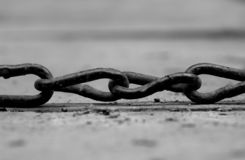 Chain. Arty shot, macro, kinda liked how chain is placed on dirty small wooden bridge stock photography