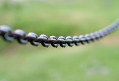 Chain. DOF shot on green Royalty Free Stock Images