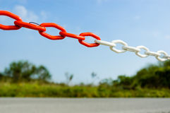 The chain. A chain to delimitate the space. It can be a symbol of link too Royalty Free Stock Photo