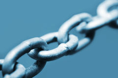 Chain. Abstract of galvanized steel chain links, in blue tone.  Shallow DOF Royalty Free Stock Photo