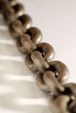 Chain. Old weathered industrial steel chain for use as background royalty free stock image