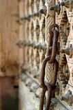 Chain. Rusty chain on an old wooden door Stock Photo