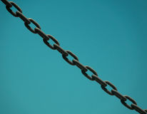 Chain Against Blue Sky. Closeup of Heavy Metal Chain Links Against Blue Sky with Copyspace Royalty Free Stock Images
