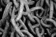 Chain from the anchor of a fishing boat, chain links in black and white royalty free stock image