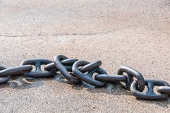 Chain for anchor from metal heavy iron on a gray background with a shadow. Side view stock photos