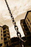 Chain and apartment blocks Stock Photography