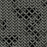 Chain armour. Ring or chain mail armour background with missing links, tiles seamlessly Stock Images