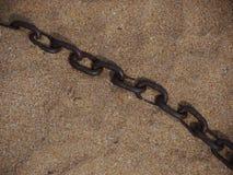 Chain beach sand. Chain on the beach in sand stock photo
