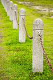 Chain Boundary. Boundary marked by granite posts linked with a single chain stock photography
