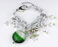 Chain bracelet. With green beads Stock Image