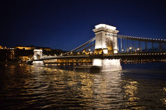 The Chain Bridge. A nighttime photo of the Chain Bridge in Budapest, Hungary. The bridge spans the Danube River Stock Photo
