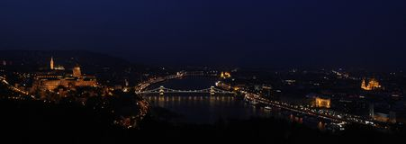 Panoramic view from Géllert Hill at sunset in Budapest Hungary. The Chain Bridge, Buda castle, the Basilica illuminated as main elements of the landscape royalty free stock image