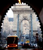 The Chain bridge in Budapest in diminishing perspective. The Chain bridge in Budapest viewed from the Tunnel in diminishing perspective with tour bus and car royalty free stock photography