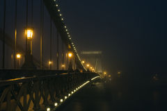Chain Bridge in Budapest, Hungary, the fog, evening lights Stock Photography
