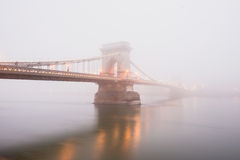Chain Bridge in Budapest, Hungary, the fog, evening lights Stock Images