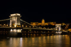 Chain bridge Budapest Hungary illuminated at night with old pala Stock Photo