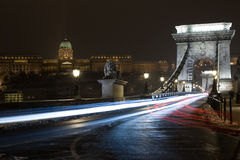 Chain bridge of Budapest, Hungary by night. Szechenyi Chain bridge (Lanchid) over the Danube river and Buda castle of Budapest, Hungary by night, with lights of Royalty Free Stock Image