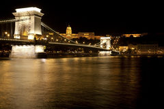 Chain Bridge in Budapest at night. Budapest at night with view to the Chain Bridge (Széchenyi Lánchíd) over the Danube (Duna), with the Buda castle in the Stock Photos