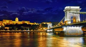 Chain bridge in Budapest nighttime. Royal palace and Chain bridge in Budapest in night, Hungary. Panorama of evening landscape of Buda city district after stock photos