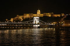 Chain Bridge, Budapest. A well-lit Chain bridge and the Buda castle in the background Royalty Free Stock Image