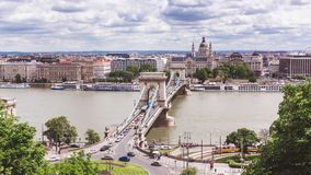 Chain bridge on Danube river in Budapest city. Hungary. Urban landscape panorama with old buildings. In summer time royalty free stock images