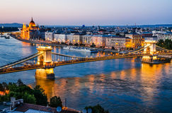Chain Bridge and Danube River, night in Budapest. Budapest, Hungary. Szechenyi or Chain Bridge is a suspension bridge on river Danube, with Orszaghaz Parliament