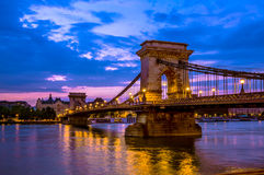 Chain Bridge at dawn in Budapest, Hungary. Szechenyi Chain Bridge is a suspension that spans the River Danube between Buda and Pest, in Budapest, the capital of Stock Photography
