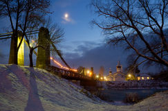 Chain Bridge of Island and the church of St. Nicholas in the eve. January 3, 2017 g, a unique chain bridge and the church of St. Nicholas in the city of Pskov royalty free stock images