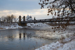 Chain Bridge of Island and the church of St. Nicholas. January 3, 2017 g, a unique Chain Bridge and St. Nicholas Church in the city Island of the Pskov region royalty free stock images