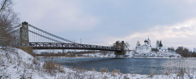 Chain Bridge of Island and the church of St. Nicholas. January 3, 2017 g, a unique Chain Bridge and St. Nicholas Church in the city Island of the Pskov region royalty free stock photo