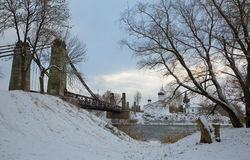 Chain Bridge of Island and the church of St. Nicholas. January 3, 2017 g, a unique Chain Bridge and St. Nicholas Church in the city Island of the Pskov region stock images