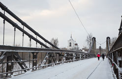 Chain Bridge of Island and the church of St. Nicholas. January 3, 2017 g, a unique Chain Bridge and St. Nicholas Church in the city Island of the Pskov region stock photos