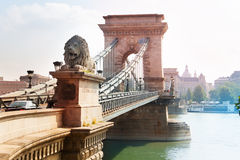 Chain bridge with monument of lion in Budapest Stock Photo