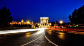 Chain Bridge by Night, Budapest. The famous Chain Bridge in Budapest lit up in the night. The picture shows the traffic on the chainbridge Royalty Free Stock Image