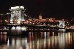The chain bridge by night. The chain bridge in Budapest by night with light reflections Stock Photography