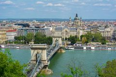 Chain Bridge over Danube river and St. Stephen`s Basilica, Budapest, Hungary royalty free stock photos