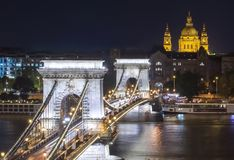 Chain Bridge over Danube river and St. Stephen`s Basilica at night, Budapest, Hungary royalty free stock photos