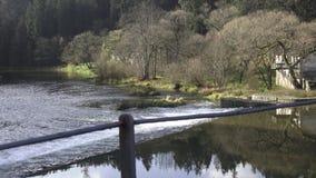 Chain bridge over the river Vltava in Czech Republic stock footage