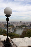 Chain Bridge Panorama in Budapest from Buda Hill. Panoramic shot of Budapest from the Buda side of the Danube River with Street lamp in foreground Royalty Free Stock Image