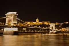 Chain Bridge, Royal Palace and Danube river in Budapest at night stock image