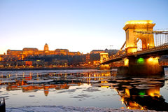 The Chain Bridge and the Royal Palace at sunset over the icy Dan Royalty Free Stock Photography