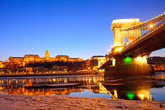 The Chain Bridge and the Royal Palace at sunset over the icy Dan Stock Photo