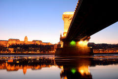 The Chain Bridge at sunset over the icy Danube River, Budapest, Royalty Free Stock Images