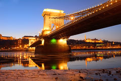 The Chain Bridge at sunset over the icy Danube River, Budapest, Royalty Free Stock Image