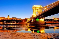 The Chain Bridge at sunset over the icy Danube River, Budapest, Stock Photo