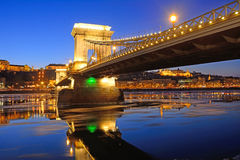 The Chain Bridge at sunset over the icy Danube River, Budapest, Stock Photography
