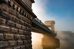 Chain brifge in Budapest. Chain bridge in Hyngarian capital - budapest durind the foggy morning after sunrise Stock Photos