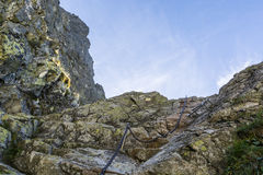 Chain and buckles on a mountain trail. Royalty Free Stock Photography