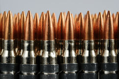 Chain of bullets over white, horizontal Stock Image