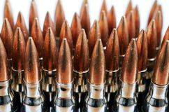 Chain of bullets over white, closeup Stock Photo